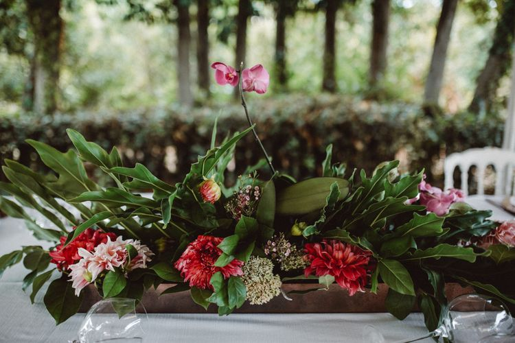 Floral Arrangement | Tropical Green & Fuchsia Pink Outdoor Wedding at Castellina de Miremont, Italy Planned & Styled by Come le Ciliegie Wedding & Events | Images by Effeanfotografie | Film by Headshot Weddings