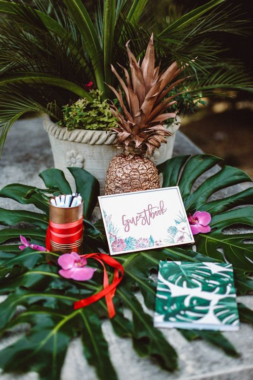 Guest Book Wedding Decor | Tropical Green & Fuchsia Pink Outdoor Wedding at Castellina de Miremont, Italy Planned & Styled by Come le Ciliegie Wedding & Events | Images by Effeanfotografie | Film by Headshot Weddings