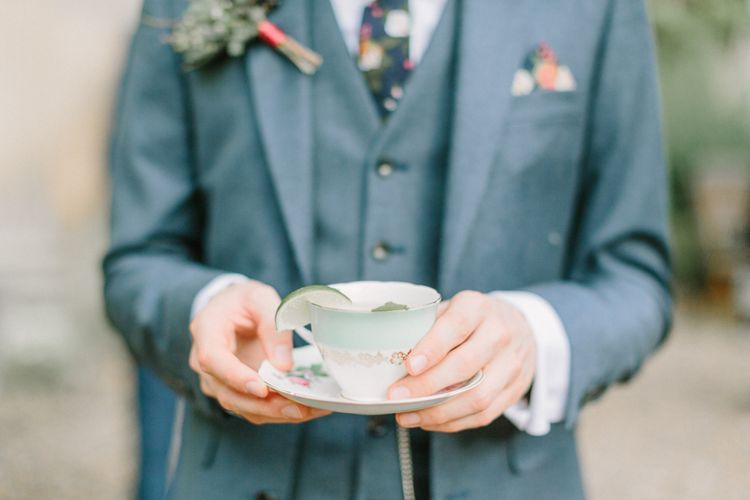 Groom in Next Three Piece Light Blue Suit with Vintage China