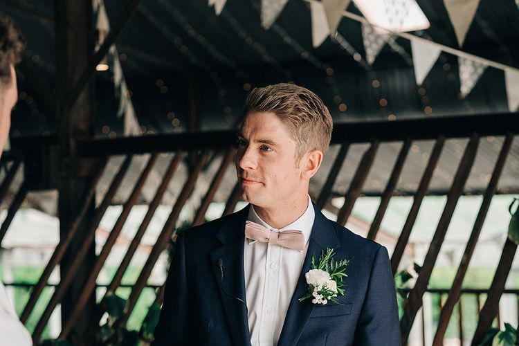 Groom In Pale Pink Bowtie // Rue De Seine Bride For A Stone Barn Wedding With Wedding Party In Soft Pink And Navy And Images From Jason Mark Harris With Film By Harris Films