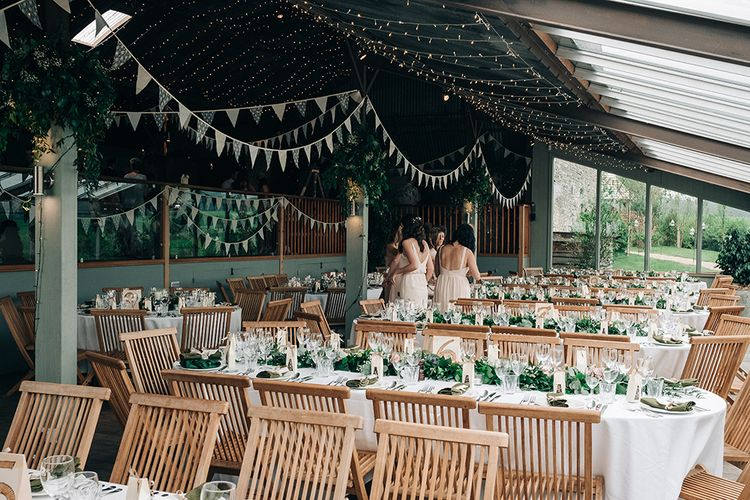 Stone Barn Wedding Reception // Rue De Seine Bride For A Stone Barn Wedding With Wedding Party In Soft Pink And Navy And Images From Jason Mark Harris With Film By Harris Films