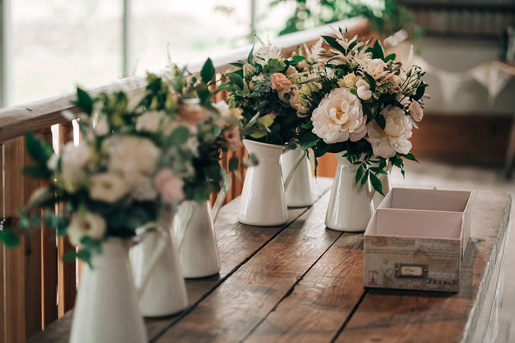 Bridesmaids Bouquets In Pinks And Whites // Rue De Seine Bride For A Stone Barn Wedding With Wedding Party In Soft Pink And Navy And Images From Jason Mark Harris With Film By Harris Films