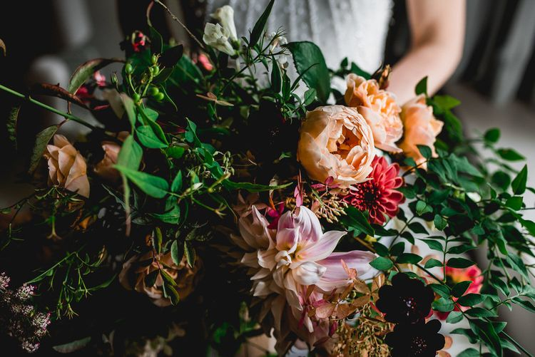 Oversized Seasonal Wedding Bouquet By The Garden Gate Flower Company // Embellished Jenny Packham Gown Marquee Wedding At Coombeshead Farm Cornwall The Garden Gate Flower Co Planning Jenny Wren Events Images Barney Walters Photography