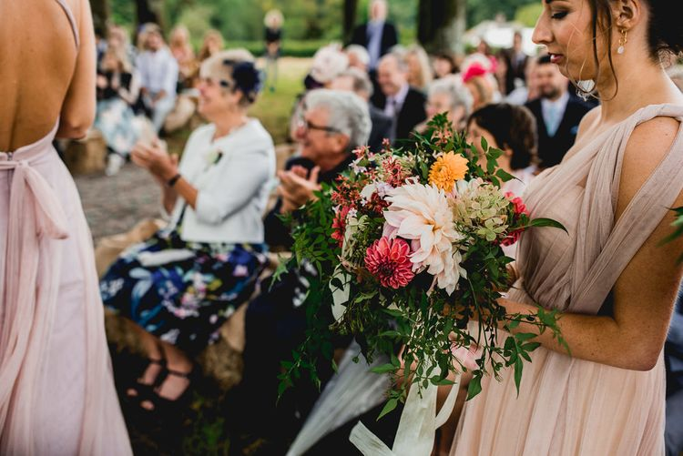 Tree Copse Wedding Ceremony With Hay Bale Seating // Farm Wedding Venue Cornwall // Embellished Jenny Packham Gown Marquee Wedding At Coombeshead Farm Cornwall The Garden Gate Flower Co Planning Jenny Wren Events Images Barney Walters Photography