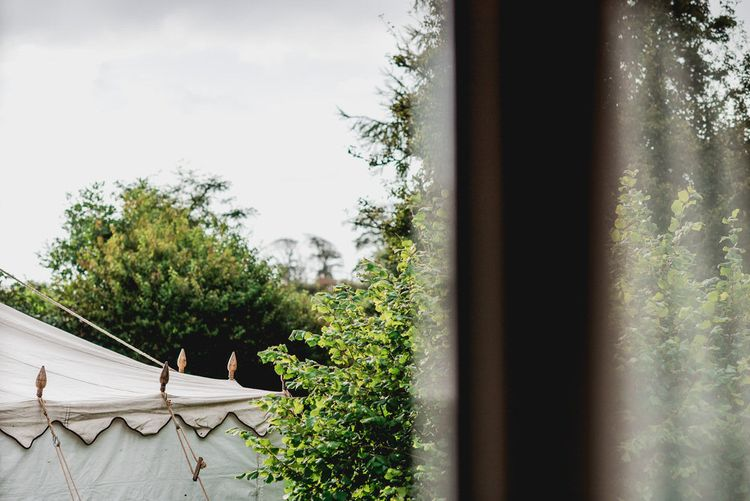 Marquee From LPM Bohemia // Embellished Jenny Packham Gown Marquee Wedding At Coombeshead Farm Cornwall The Garden Gate Flower Co Planning Jenny Wren Events Images Barney Walters Photography