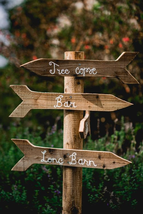 Wooden Signage For Wedding // Embellished Jenny Packham Gown Marquee Wedding At Coombeshead Farm Cornwall The Garden Gate Flower Co Planning Jenny Wren Events Images Barney Walters Photography