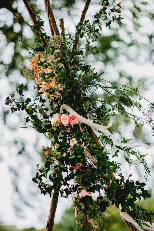 Seasonal Wedding Flowers By The Garden Gate Flower Company // Floral Lined Marquee For Wedding // Embellished Jenny Packham Gown Marquee Wedding At Coombeshead Farm Cornwall The Garden Gate Flower Co Planning Jenny Wren Events Images Barney Walters Photography