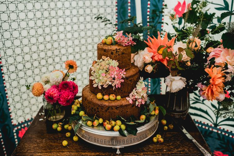 Rustic Wedding Cake With Fresh Fruit And Flowers // Seasonal Wedding Flowers By The Garden Gate Flower Company // Floral Lined Marquee For Wedding // Embellished Jenny Packham Gown Marquee Wedding At Coombeshead Farm Cornwall The Garden Gate Flower Co Planning Jenny Wren Events Images Barney Walters Photography