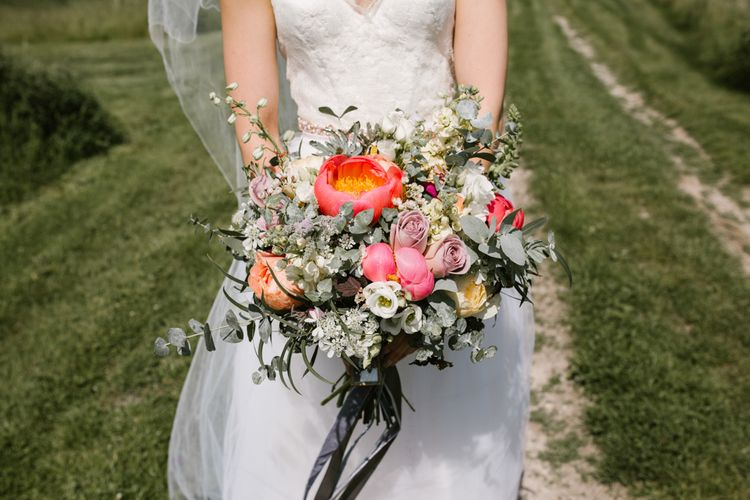Coral Peony, Rose & Eucalyptus Wedding Bouquet with Ribbon | Sarah Seven Dress | DIY Wedding at Upwaltham Barns with Bright Flowers | Danielle Victoria Photography