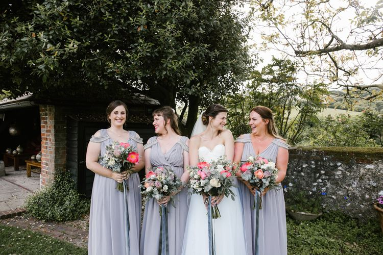 Bridesmaids in Grey ASOS Dresses | Bride in Sarah Seven Gown | DIY Wedding at Upwaltham Barns with Bright Flowers | Danielle Victoria Photography
