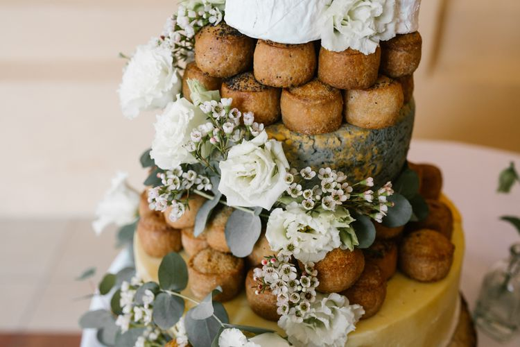 Pork Pies Wedding Cake on Rustic Tree Stump Cake Stand | DIY Wedding at Upwaltham Barns with Bright Flowers | Danielle Victoria Photography
