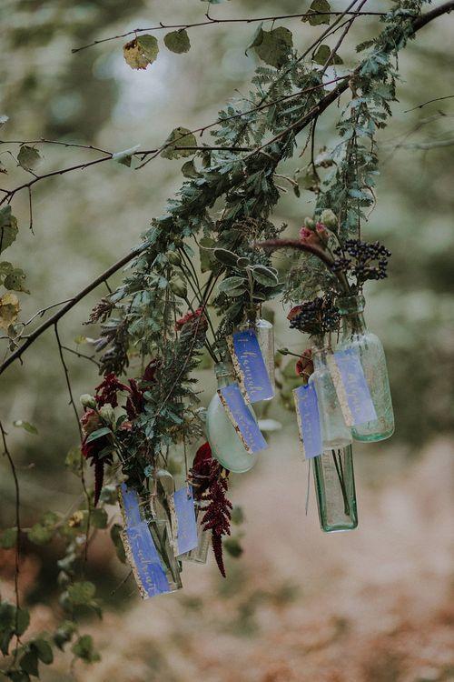 Hanging Bottles Table Plan | Woodland Bohemian Luxe Inspiration | Lola Rose Photography & Film