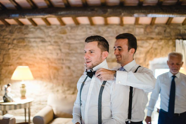 Groom in Tiger of Sweden Wedding Suit & Hugo Boss Bow Tie