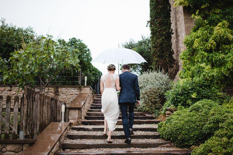 Bride & Groom under an Umbrella