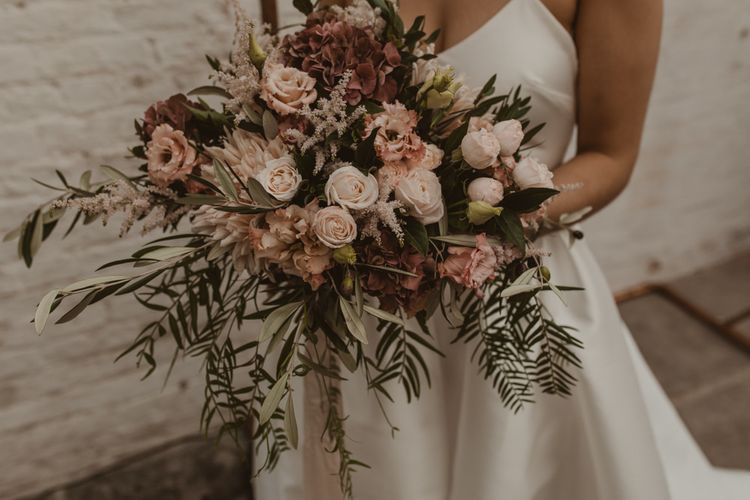 Oversized Romantic Bridal Bouquet with Pink Roses, Dahlias, Hydrangeas & Foliage | Romantic Pink and Gold Wedding Inspiration in a Modern Summer House at Garthmyl Hall by KnockKnockPenny Studio | Nesta Lloyd Photography