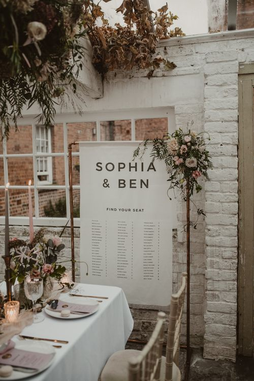 Copper Frame & Flag Table Plan with Floral Decor |  | Romantic Pink and Gold Wedding Inspiration in a Modern Summer House at Garthmyl Hall by KnockKnockPenny Studio | Nesta Lloyd Photography