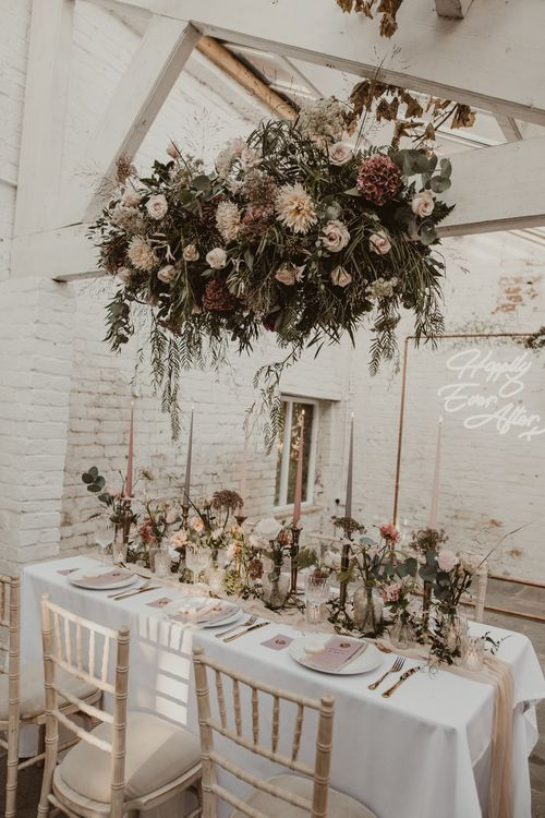 Hanging Floral Installation & Tablescape with Floral Centrepieces & Taper Candles | Romantic Pink and Gold Wedding Inspiration in a Modern Summer House at Garthmyl Hall by KnockKnockPenny Studio | Nesta Lloyd Photography