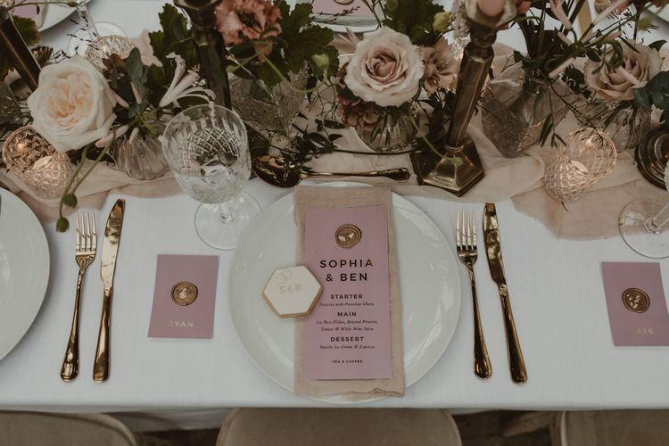 Place Setting with Pink & Gold Foil Menu Card with Wax Seal by Knockknockpenny Studio  on a Tablescape with Floral Centrepieces & Taper Candles | Romantic Pink and Gold Wedding Inspiration in a Modern Summer House at Garthmyl Hall by KnockKnockPenny Studio | Nesta Lloyd Photography