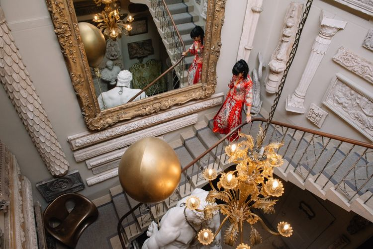 Bride in red dress for Chinese tea ceremony