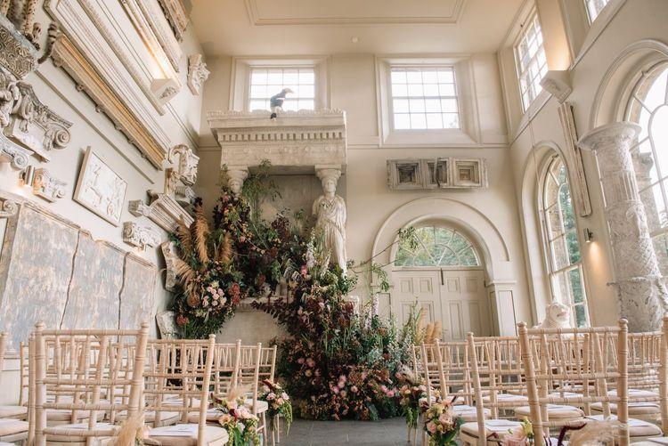Aynhoe Park wedding ceremony room  with epic flower arrangement