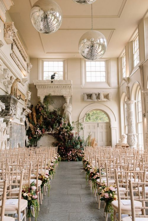 Aynhoe Park aisle and altar wedding flowers