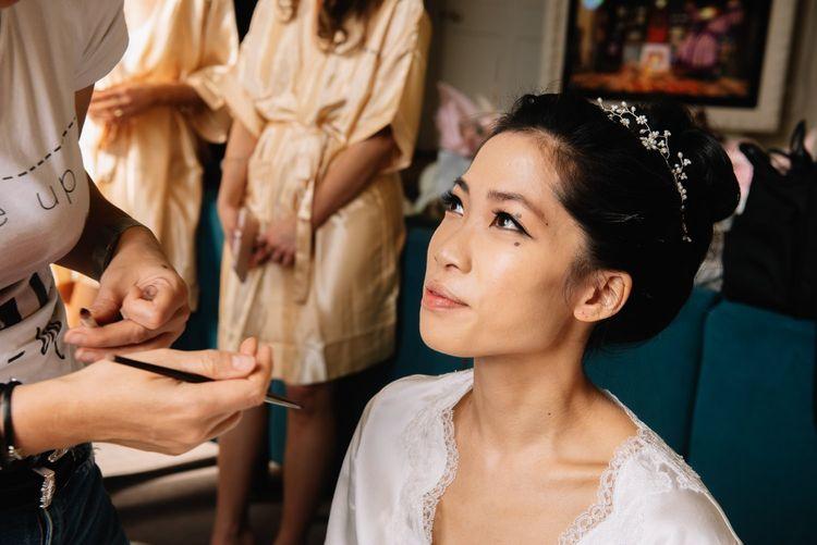 Natural bridal makeup and classic bun hairstyle