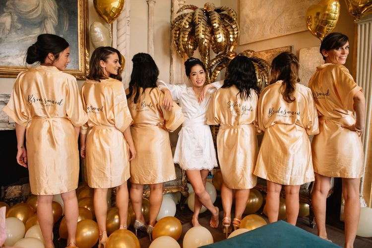 Bride and bridal party on wedding morning in getting ready robes