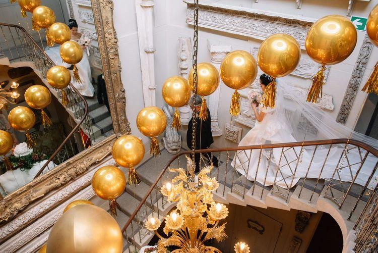 Gold balloon wedding decor at Aynhoe Park