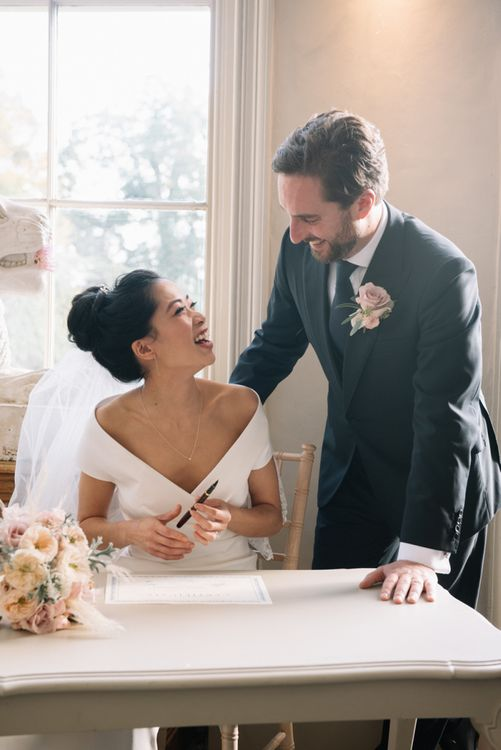 Bride and groom exchanging vows at Aynhoe Park wedding ceremony