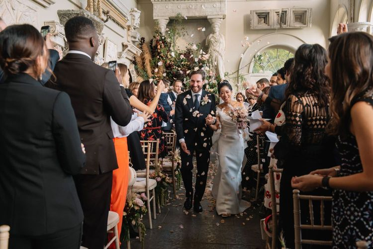 Bride and groom descending the aisle as husband and wife