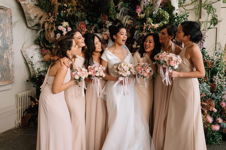 Bridal party portrait with bridesmaids in pale pink dresses