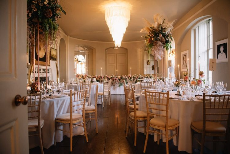 Aynhoe Park dining room with pink wedding flowers