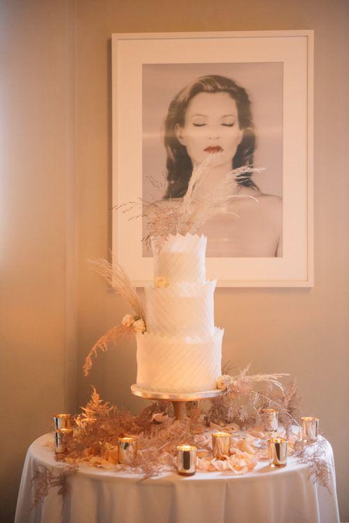 Opulent white wedding cake by Dees Basement