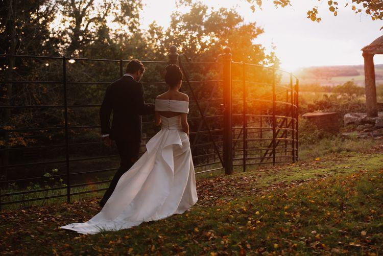 Golden hour portrait at Aynhoe Park with bride in off the shoulder wedding dress