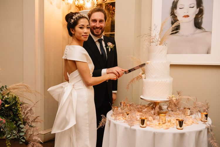Bride and groom cutting the cake at Aynhoe Park