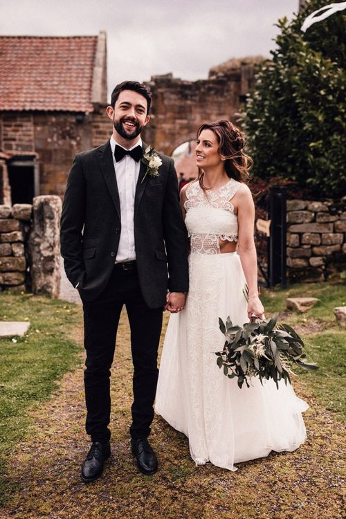 Bride in Emma Beaumont wedding dress with lace detail
