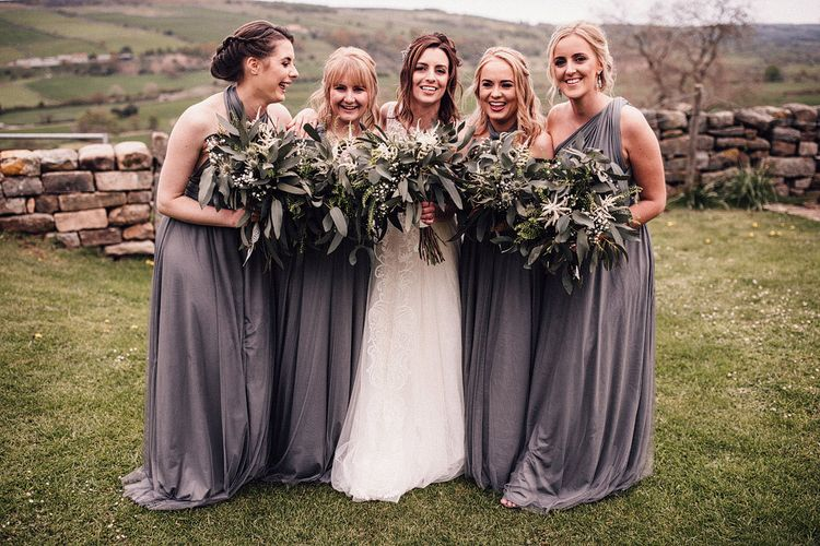 Grey bridesmaid dresses with foliage bouquets