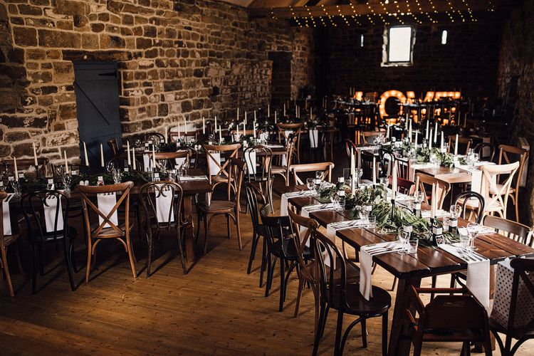 Wedding table decor with eucalyptus leaves at Danby Castle wedding