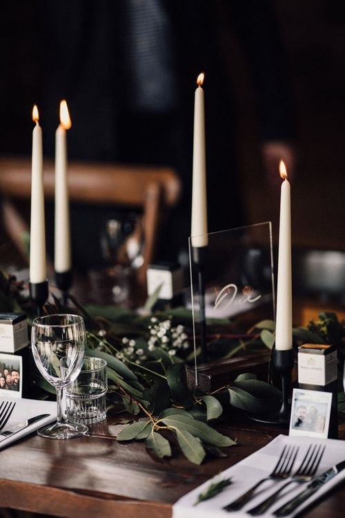 Candles and foliage wedding table decor