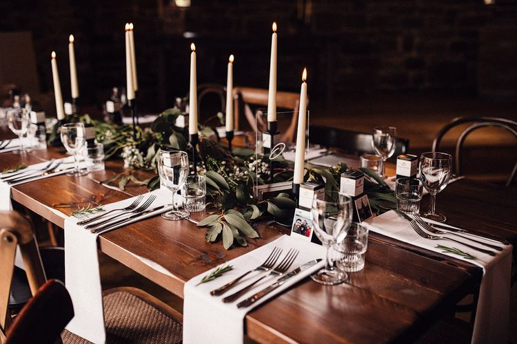 Wedding table decor with foliage table runner at Danby Castle wedding