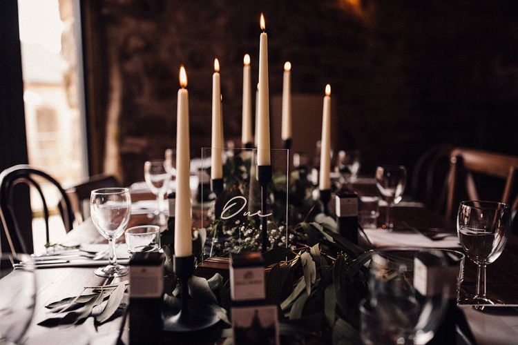 Pretty candle and foliage table decor at Danby Castle wedding