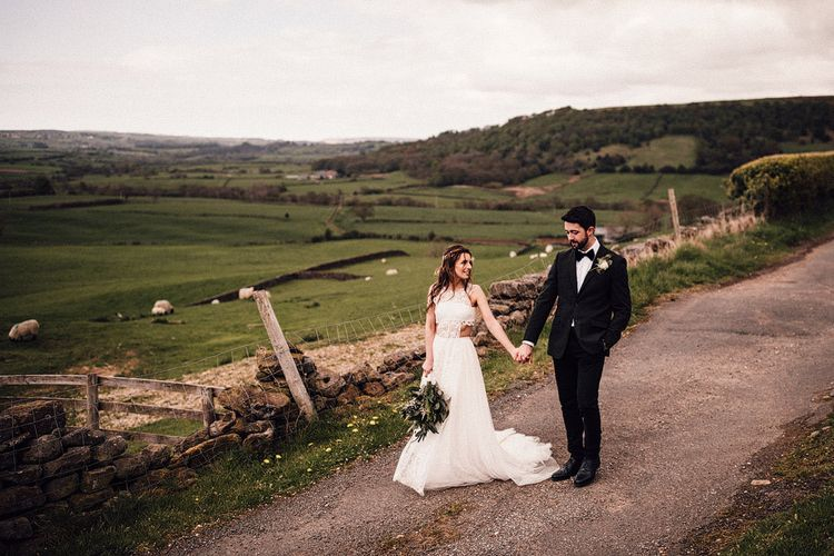 Yorkshire dales wedding with bride in Emma Beaumont wedding dress