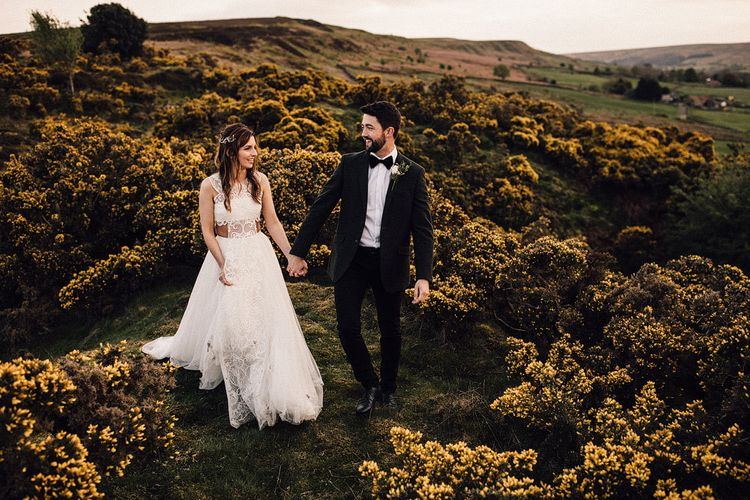Bride wears Emma Beaumont lace detail wedding dress