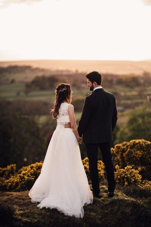 Bride and groom look out over Yorkshire dales