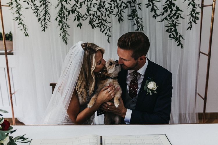 Signing of Register | Ralf the Dog | Bride in Lace Racerback Essence of Australia Wedding Dress | Groom in Navy Suit from Coneys of Lincoln | Nottinghamshire Wedding with Spanish Vibes and Rewritten Bridesmaids Dresses | Kev Elkins Photography