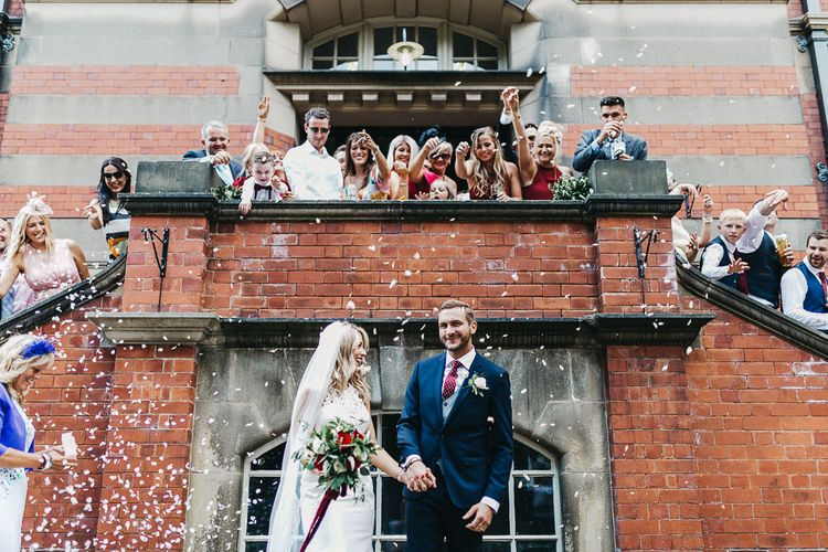 Confetti Moment | Bride in Lace Racerback Essence of Australia Wedding Dress | Groom in Navy Suit from Coneys of Lincoln | Nottinghamshire Wedding with Spanish Vibes and Rewritten Bridesmaids Dresses | Kev Elkins Photography