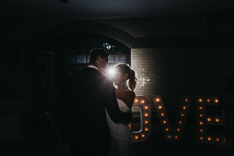 First Dance | Love Letter Lights | Bride in Lace Racerback Essence of Australia Wedding Dress | Groom in Navy Suit from Coneys of Lincoln | Nottinghamshire Wedding with Spanish Vibes and Rewritten Bridesmaids Dresses | Kev Elkins Photography