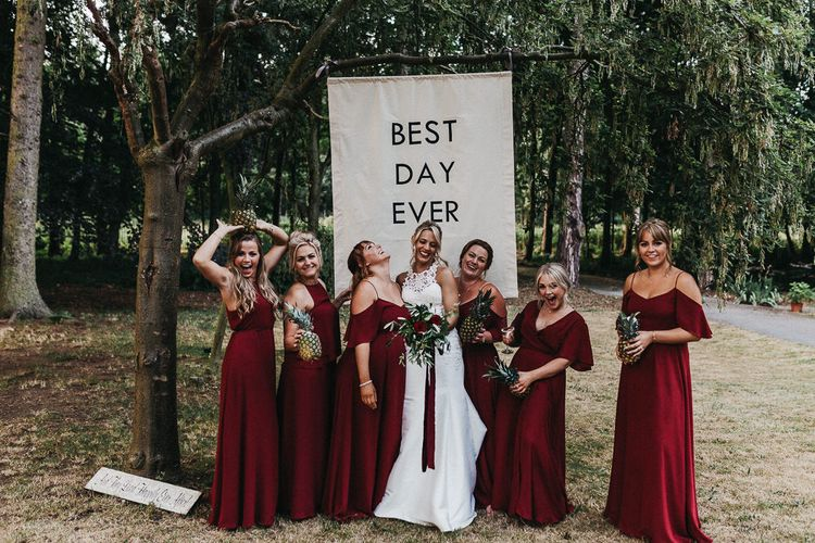 Bride in Lace Racerback Essence of Australia Wedding Dress | Bridesmaids in Mismatched Burgundy Rewritten Dresses | Nottinghamshire Wedding with Spanish Vibes and Rewritten Bridesmaids Dresses | Kev Elkins Photography