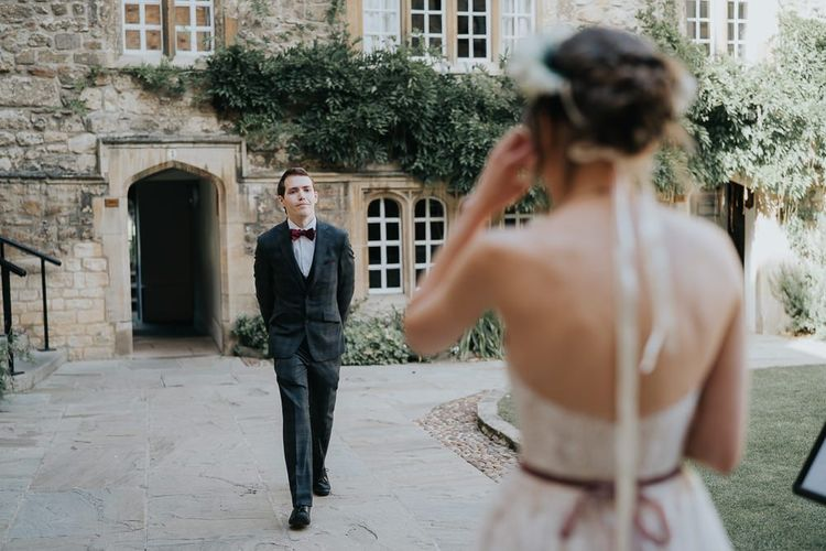 Bride and groom first look for intimate celebration with flower crown
