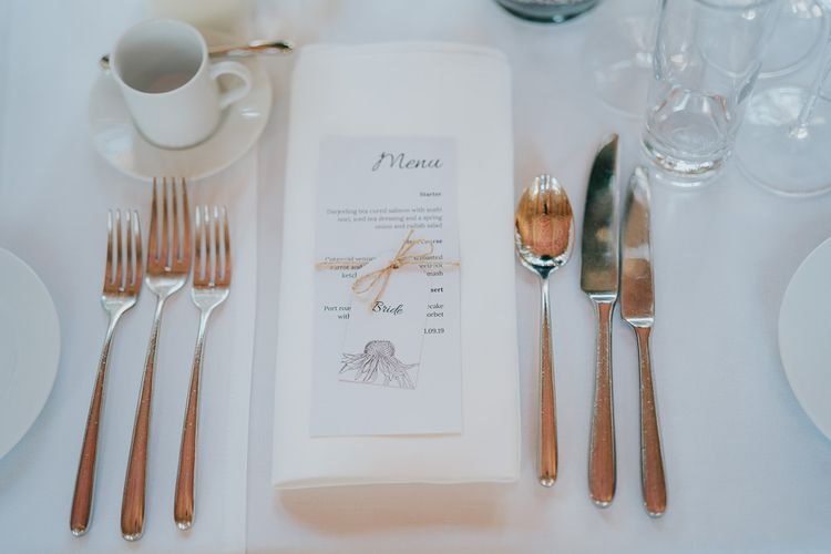 Classic table decor with place setting tied with a bow for intimate reception at Bodleian library